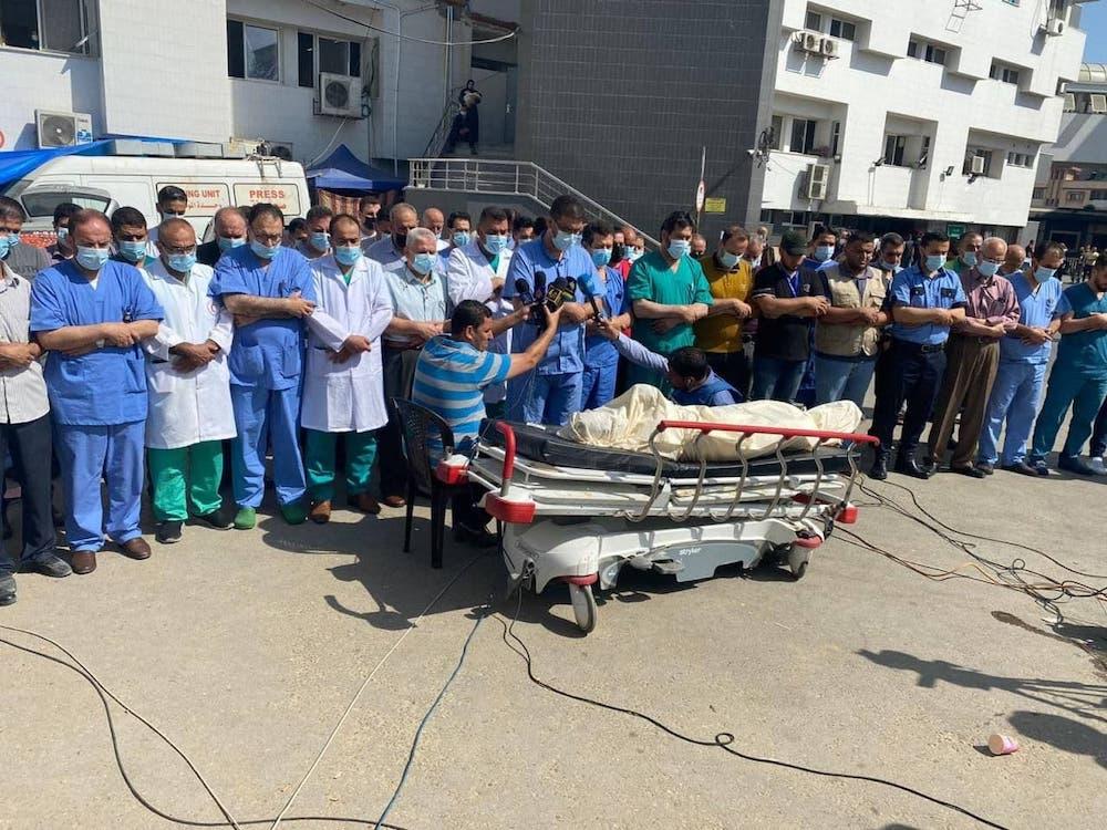 Gaza hospital staff praying