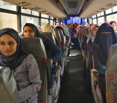 Female students using the bus